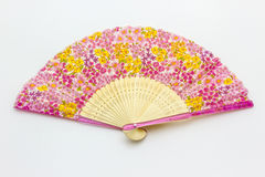 Modèle chinois de fan sur les fleurs roses Image stock