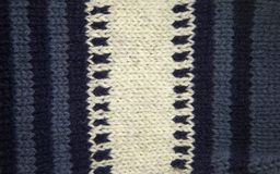 Modèle coloré aïe chaussettes fabriquées à la main d'une laine Habillement naturel Images libres de droits