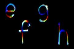 Modèle coloré produit par résumé léger de peinture d'alphabet pour le fond et la conception Images libres de droits