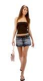 Modèle dans la jupe de jeans photo libre de droits