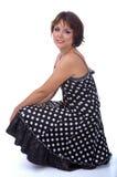 Modèle dans la robe de polka-point Photographie stock