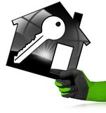 Modèle de Chambre avec la clé dans une main enfilée de gants Image libre de droits