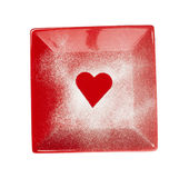 Modèle de coeur sur le fond d'une cuvette rouge Images stock
