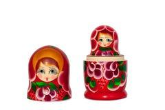 Modèle de fleurs rouge de souvenir russe de poupée de Matreshka, pourpre et vert lumineux sur le plan rapproché d'isolement par f photographie stock