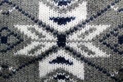 Modèle de flocon de neige tricoté par hiver de fond images stock