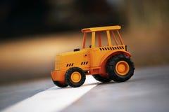 Modèle de jouet de tracteur Photo stock