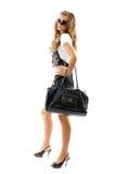 Modèle de mode avec le grand sac. photographie stock