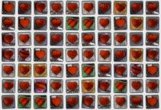 Modèle de mosaïque sans couture des coeurs de Valentine faits à partir du tex grunge Images stock