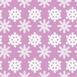Modèle de Noël avec des flocons de neige sur un fond rose Image libre de droits