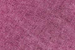 Modèle de tissu de denim dans la couleur rose Photos libres de droits