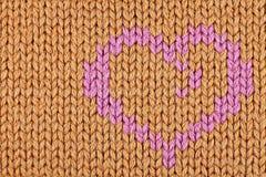 Modèle de tricotage orange avec le coeur Photo stock