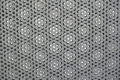 Modèle de trous perforé en acier de texture grise de grille en métal de cercles photo libre de droits