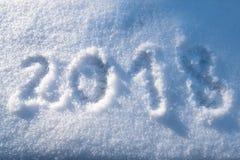 Modèle du chiffre 2018 tiré sur la neige Photographie stock