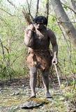 Modèle du paquet de transport d'homme de Néanderthal de bâtons Photo stock