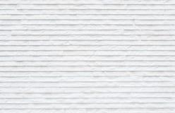 Modèle en pierre abstrait extérieur de plan rapproché au fond de marbre blanc de texture de mur en pierre Photo libre de droits