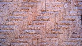 Modèle en pierre de flèche de dessous au bon fond supérieur de texture Photo libre de droits