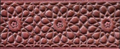 Modèle en pierre sur un mur de temple dans le fort rouge, Âgrâ Images stock