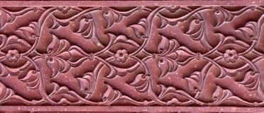 Modèle en pierre sur un mur de temple dans le fort rouge, Âgrâ Photo stock