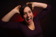 Modèle femelle affligé avec PMS Photos stock