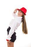 Modèle femelle avec le sourire rouge de chapeau photo stock