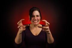 Modèle femelle avec PMS, avec des mains de griffe photo libre de droits