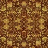 Modèle floral d'or sur le backgraund minable brun Image libre de droits