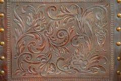 Modèle floral de vintage sur le cuir Photos libres de droits