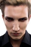 Modèle masculin sérieux avec le maquillage Image libre de droits