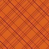 Modèle sans couture abstrait avec le tissu de plaid sur un fond orange Photos stock