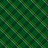 Modèle sans couture abstrait avec le tissu de plaid sur un fond vert-foncé Photographie stock libre de droits