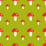 Modèle sans couture avec des champignons d'amanite Illustration Libre de Droits
