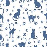 Modèle sans couture avec des chats et des traces illustration libre de droits