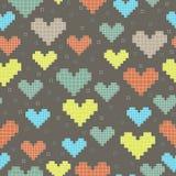 Modèle sans couture avec des coeurs de pixel sur un fond foncé Photo stock