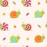 Modèle sans couture avec des escargots et des bonbons de sucrerie de bande dessinée Photos libres de droits