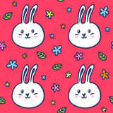Modèle sans couture avec des lapins et des fleurs de griffonnage Photos libres de droits