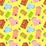 Modèle sans couture avec des maisons et arbre sur le fond jaune Images stock
