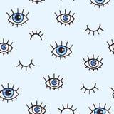Modèle sans couture avec des yeux sur un fond bleu Fond de Bohème de style pour la conception La copie abstraite d'ouvert et ferm Image libre de droits