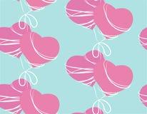 Modèle sans couture avec deux coeurs roses Images libres de droits