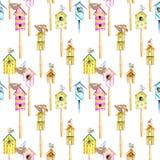 Modèle sans couture avec les volières colorées d'aquarelle, les oiseaux mignons et les nids Photo stock