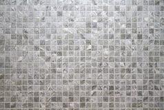 Modèle sans couture carrelé gris de mur images stock