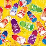 Modèle sans couture - chaussures en caoutchouc colorés d'enfants Image stock