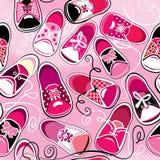 Modèle sans couture - chaussures en caoutchouc d'enfants sur le backg rose Photos stock