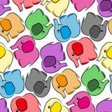 Modèle sans couture d'éléphants multicolores Photos stock