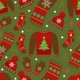 Modèle sans couture d'habillement d'hiver Vêtements de Noël répétant la texture Fond infini d'habillement chaud Chandail, gants Image libre de droits