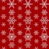 Modèle sans couture d'hiver avec des lignes des flocons de neige blancs sur le fond rouge Photos libres de droits