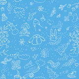 Modèle sans couture d'hiver sur un fond bleu Image libre de droits