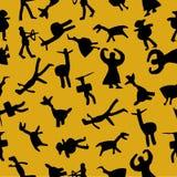 Modèle sans couture d'homme des cavernes au fond jaune Photo stock
