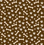 Modèle sans couture d'os de chien Os et traces de texture répétitive de pattes de chiot Fond sans fin de chienchien Vecteur Images libres de droits