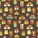 Modèle sans couture de cadeaux sur le brun Image stock