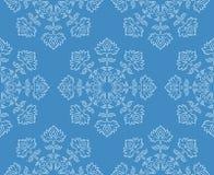 Modèle sans couture de flocon de neige floral blanc ethnique tiré par la main de style d'imagination sur le bleu, illustration de Image libre de droits